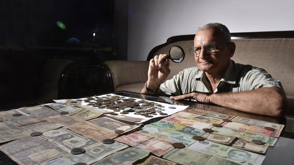 D.C.Ahuja shows antique coins and currency collection at his residence in Gurugram. Ahuja has been collecting coins since his childhood and became an ardent collector in 2013, after attending a coins and notes exhibition in New Delhi. The oldest coin he has is the 'quarter anna' of 1835, minted by the East India Company. (Sanjeev Verma / HT Photo)