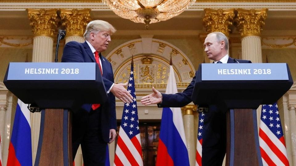US President Donald Trump and Russia's President Vladimir Putin during a joint news conference after their meeting in Helsinki, July 16