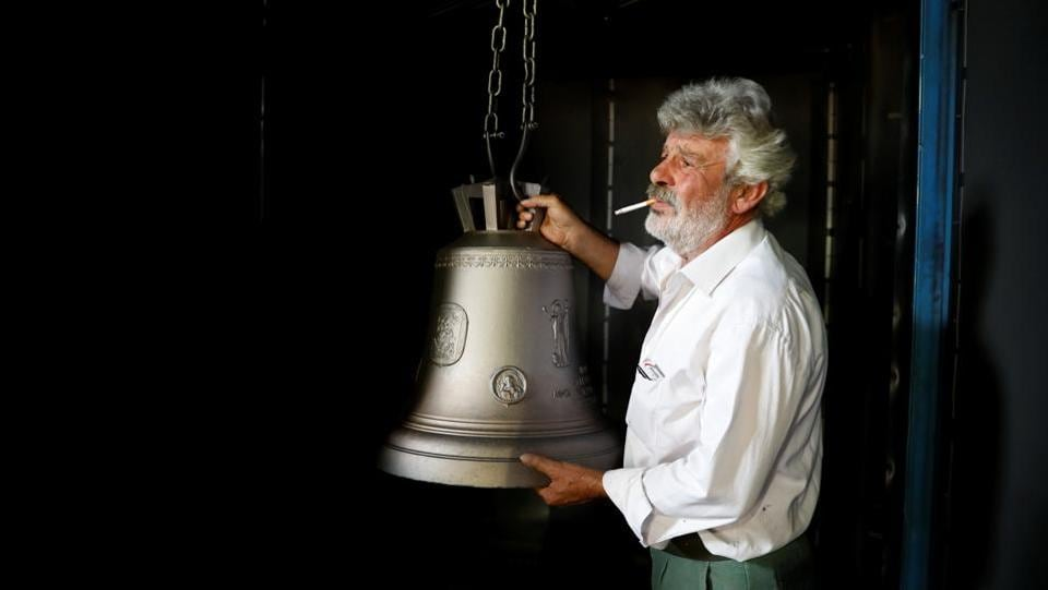 Thomas Galanopoulos, 59, holds a cleaned bell at his family's bell foundry. In one of Greece's last remaining bell foundries in the small, western town of Paramythia, the Galanopoulos brothers are busy casting church bells heading to Ethiopia and Romania, pouring red-hot molten metal into moulds of varying sizes. (Alkis Konstantinidis / REUTERS)