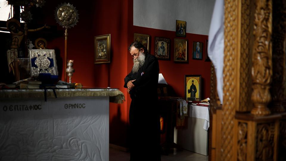 Father Theodoros Zois, who bought six bells from the Galanopoulos, prays inside his church in Igoumenitsa, Greece. The Greek Orthodox Church permeates life in Greece. But when the economic crisis hit, domestic demand collapsed. The Church, not spared by the crisis, cut expenses to meet the costs of its soup kitchens and charities. Building or restoration work on churches often ceased. (Alkis Konstantinidis / REUTERS)
