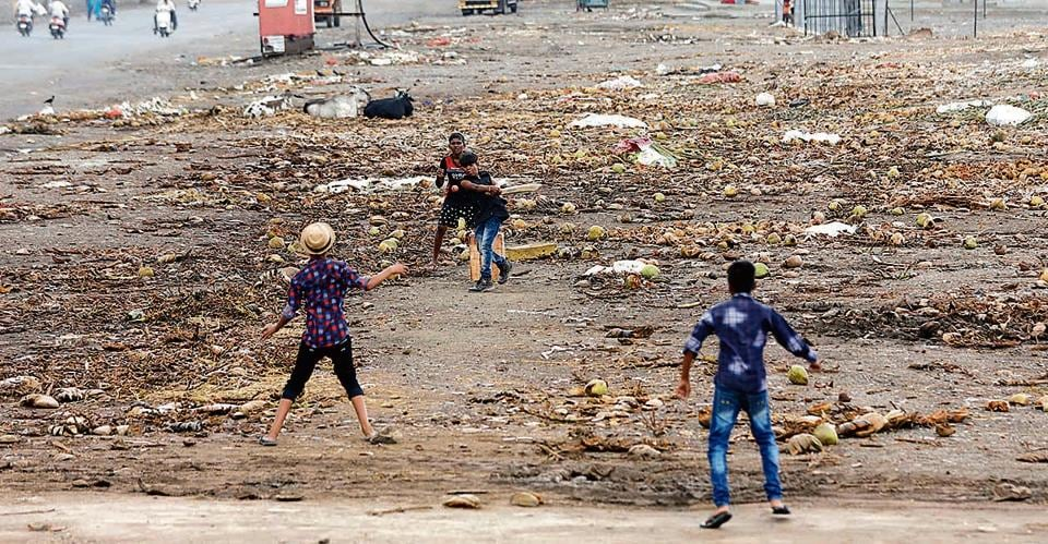 Children play cricket at Market Yard, the 'rubbish' outfield notwithstanding.  (HT Photo)