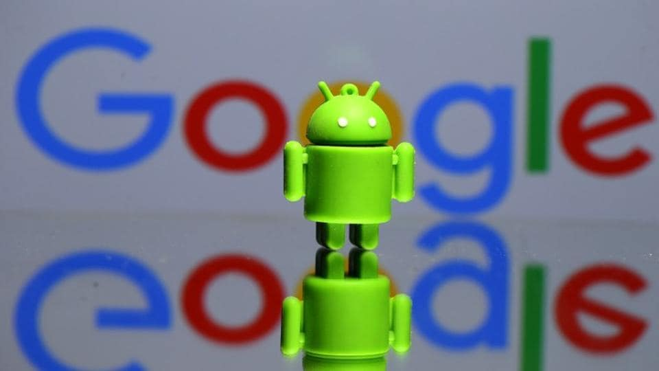 A 3D printed Android mascot Bugdroid is seen in front of a Google logo in this illustration taken on July 9.