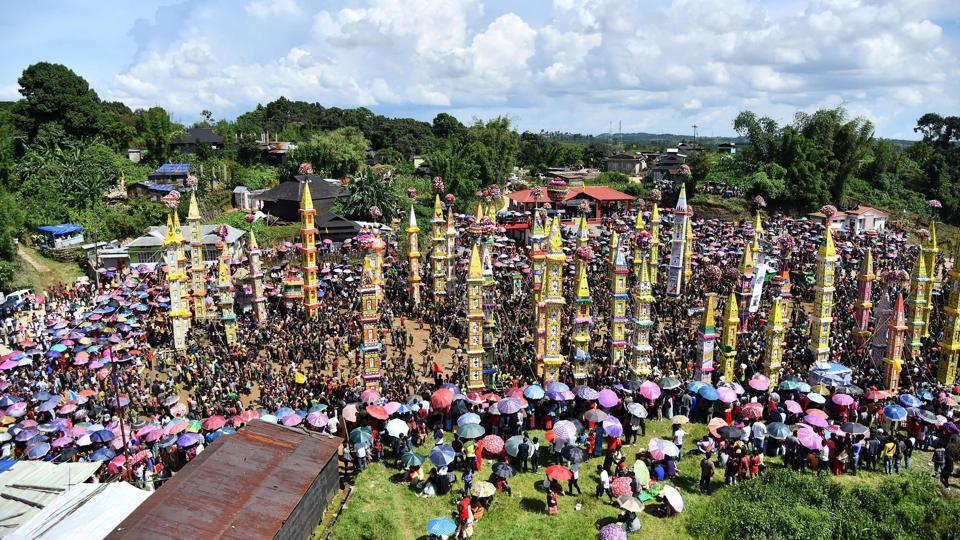 Indian villagers watch as Pnar, or Jaintia, tribesmen carry traditional Raths or chariots during events to mark the Behdienkhlam festival in Tuber village in Meghalaya on July 19.