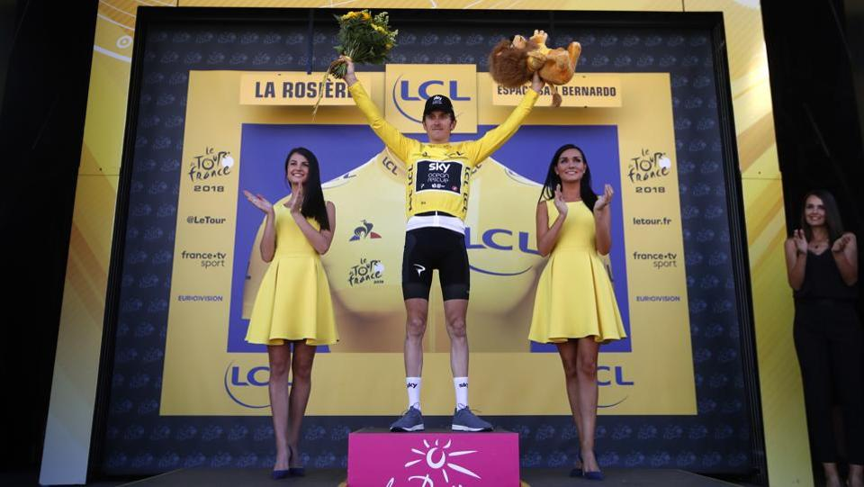 Stage winner Britain's Geraint Thomas and new overall leader celebrates on the podium after the eleventh stage over 108.5 kilometers with start in Albertville and finish in La Rosiere Espace San Bernardo, France. (Christophe Ena  / AP)