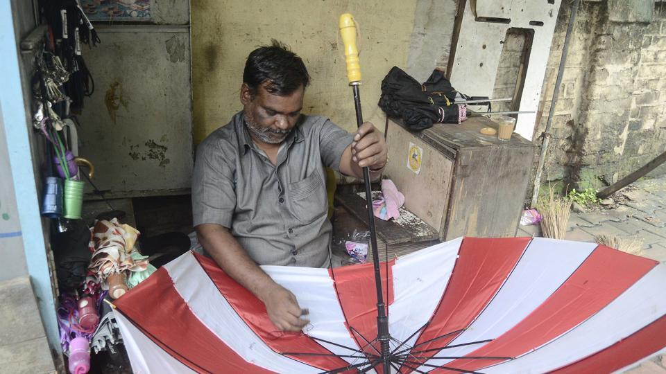 With the rains taking a break, umbrella repairs were on in full swing at Sadashiv peth. (HT photo)