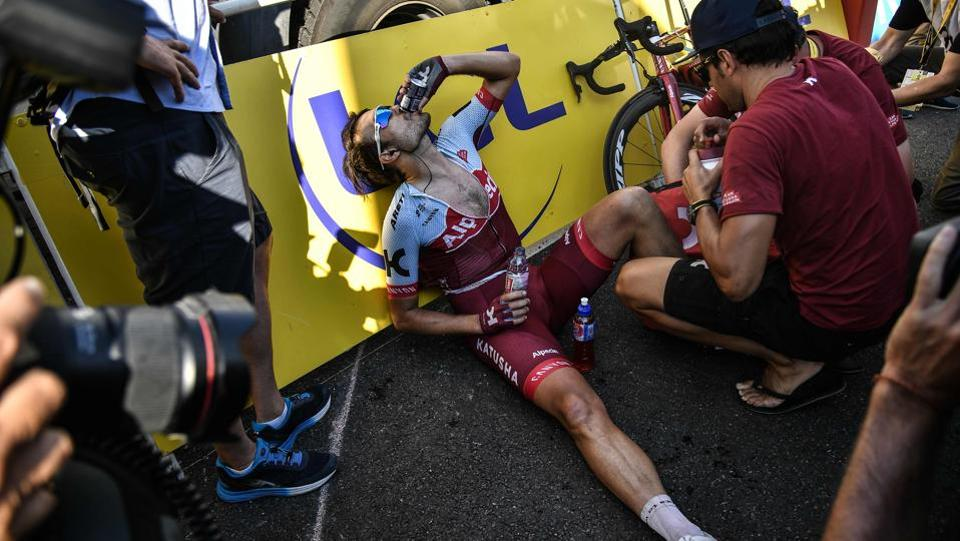 Germany's Rick Zabel drinks after he crossed the finish line to place 162nd and last of the eleventh stage between Albertville and La Rosiere, French Alps, on July 18, 2018. (Marco BERTORELLO / AFP)