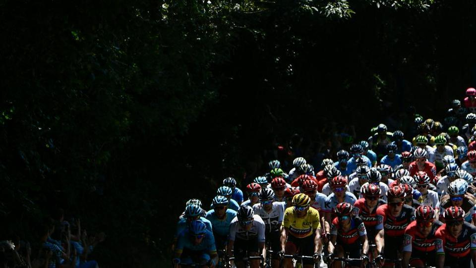 Belgium's Greg Van Avermaet (C) and riders of the pack ride through a forest during the fifth stage of the cycling race on July 11, 2018. (Philippe Lopez / AFP)