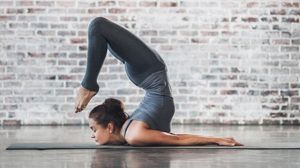 Stop weight gain: Yoga is one of the simplest exercises you can do while holidaying.