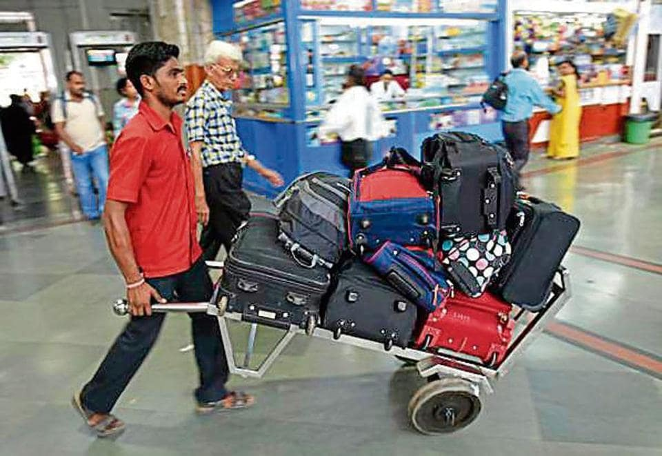 Currently, porters carry luggage on plank-like trolleys (above), but the new ones will resemble those used at airports.