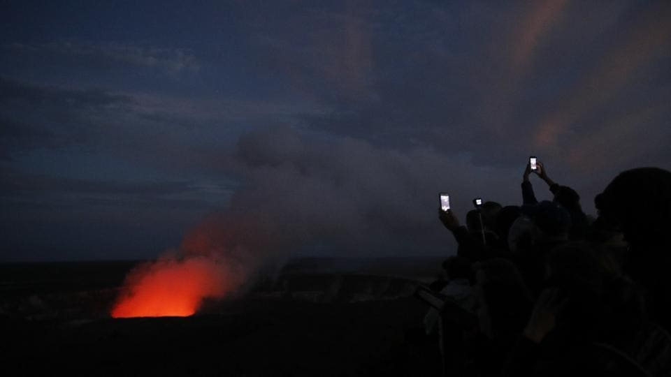 "Currently, only helicopter and boat-tour passengers — paying about $250 each — are able to see the lava in person. John Tarson, owner of Epic Lava Tours, said the current restrictions are crushing him. ""They've effectively cut my business' legs off. And there's nothing that can be done to save it unless they reopen the tourism industry, unless they stop criminalizing people for wanting to see lava,"" Tarson said. (Jae C. Hong / AP)"