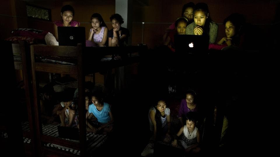 Children at a school hostel watch the World Cup soccer final match between France and Croatia on laptops, on the outskirts of Guwahati, Assam on July 15, 2018. (Anupam Nath / AP)