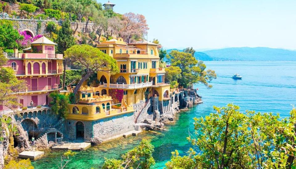 Portofino, Italy, is known for its brightly-coloured houses. A fishing village, it is also dotted with high-end boutiques and seafood restaurants. It also boasts of a 16th fortress and museum that offers views of the town.  (Shutterstock)