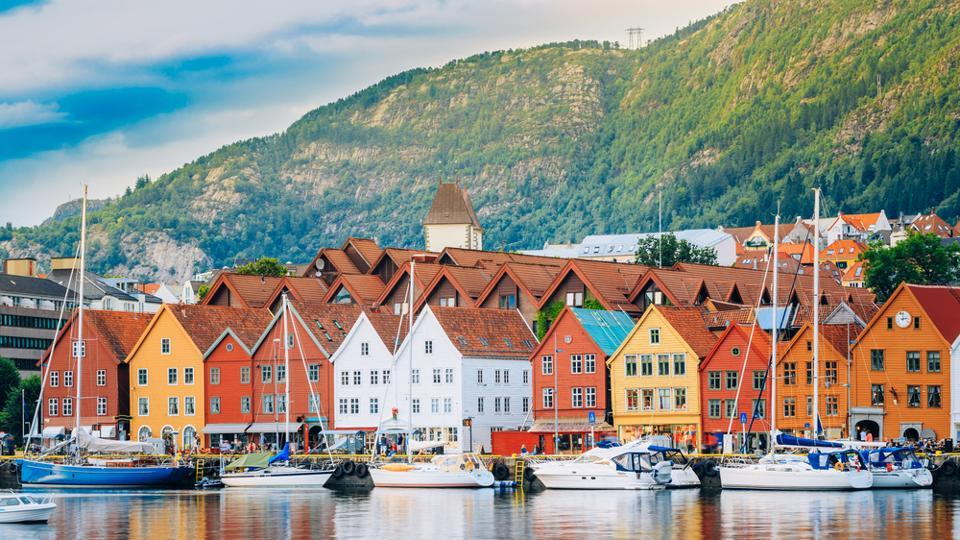 Bergen in Norway is surrounded by seven mountains and fjords. Thre are picture perfect, vibrant wooden houses on the wharf. You can take a ferry for a tour of the fjords. Try the sumptous seafood available at the waterside restaurants.  (shutterstock)