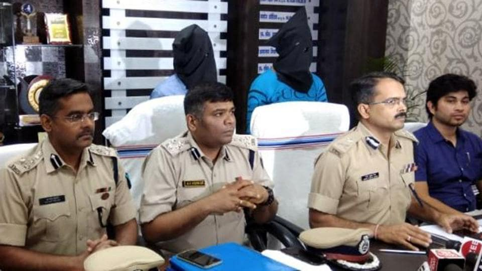 Police officials with the arrested accused in Kochang gangrape case John Junas Tudu and Balram Samad during a press conference in Khunti on Sunday.