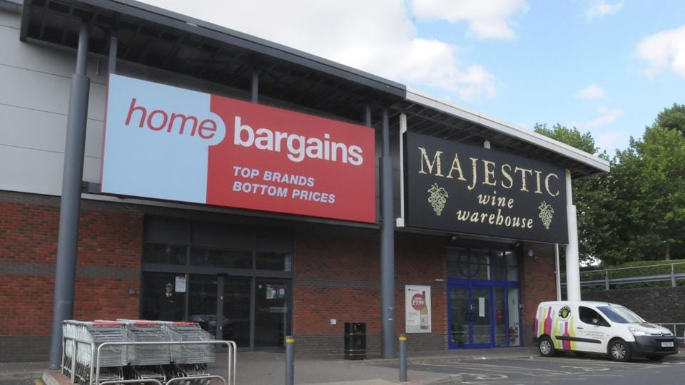 A general view of the Home Bargains store where a man is accused of an acid attack on a young boy, in Worcester, England, Sunday. British police say a 3-year-old boy suffered severe burns on his face and arm during a suspected acid attack that investigators think was deliberate.