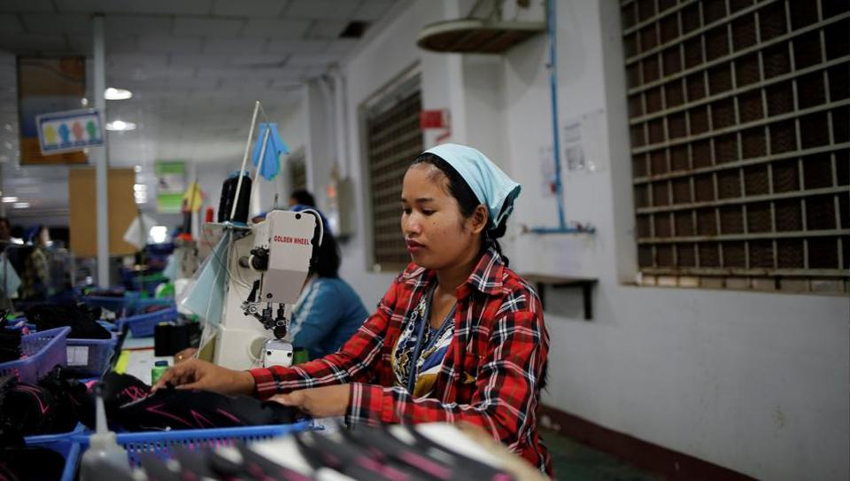 Khen Srey Touch, 27, sews shoes at Complete Honour Footwear Industrial, a footwear factory owned by a Taiwan company, in Kampong Speu, Cambodia. Whoever wins Cambodia's general election next week, 27-year-old knows only that she will have to keep working hard for years to come. (Ann Wang / REUTERS)