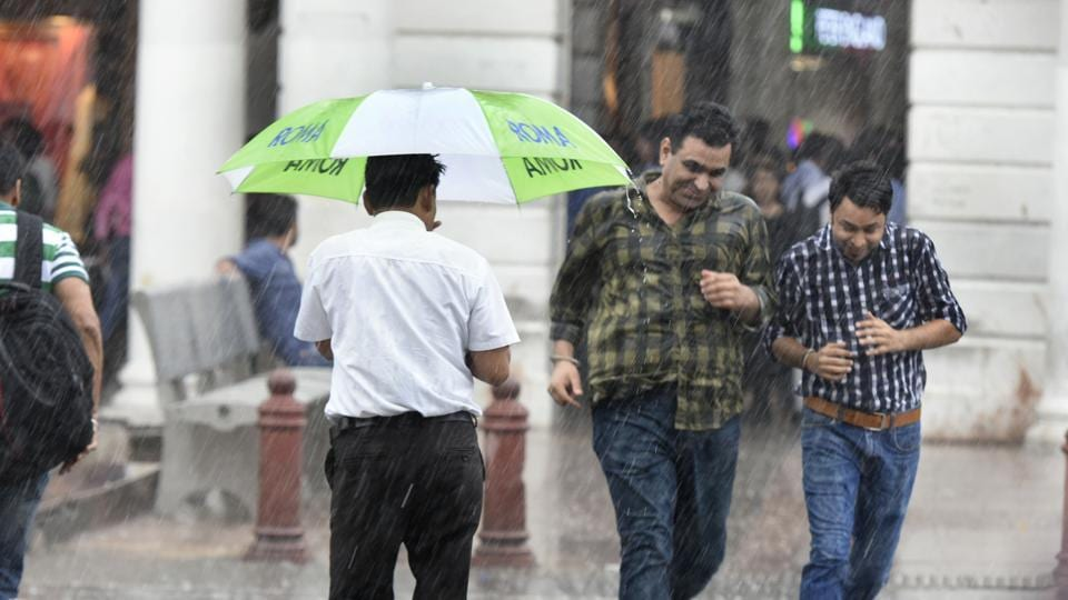 People caught up in rain in New Delhi  on Monday, July 16, 2018.  Today, it is considered hazardous to even stand in the rain in our noxious cities where a downpour washes the air of suspended pollutants.