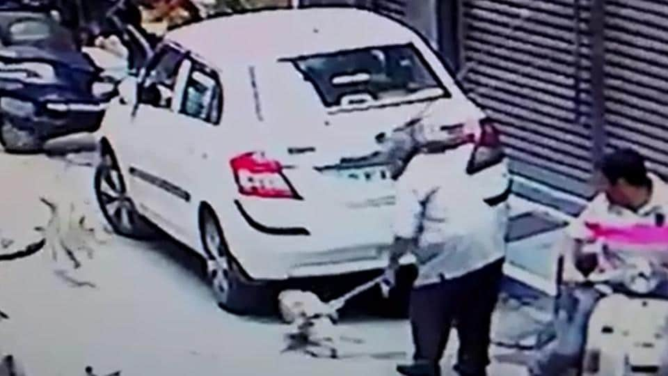 CCTV footage from the neighbourhood shows a man dragging a dog with a chain around its neck.