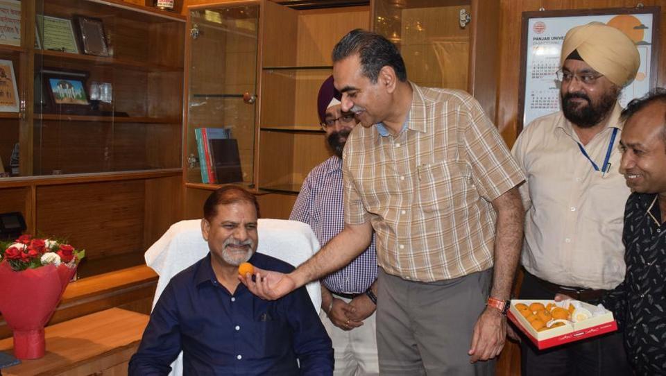 Local BJP chief and senator Sanjay Tandon welcoming vice-chancellor Prof Raj Kumar at Panjab University on Monday.