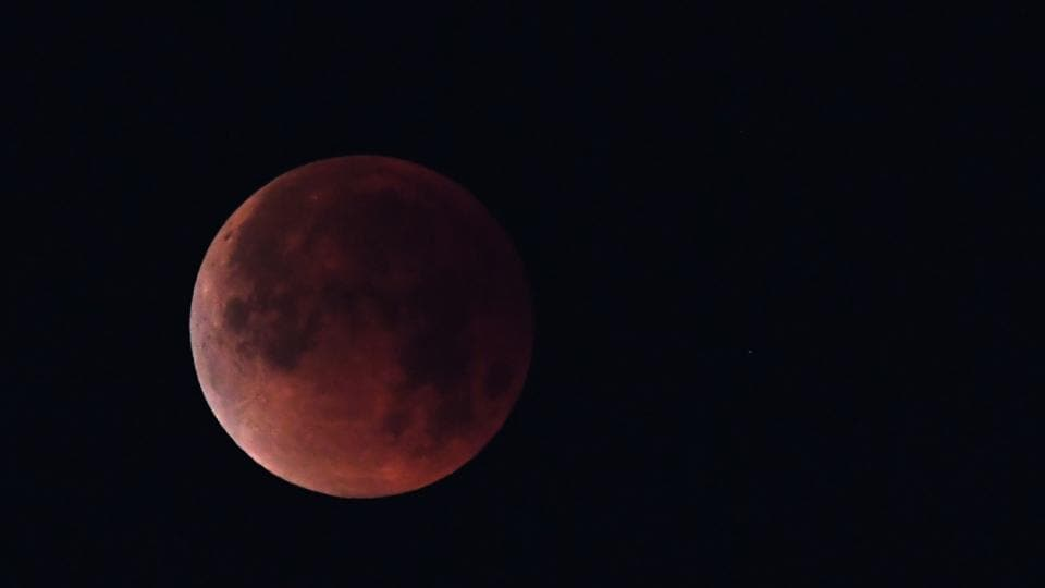 In this file photo taken on January 31, 2018 the 'super blue blood moon' is seen over Los Angeles, California.