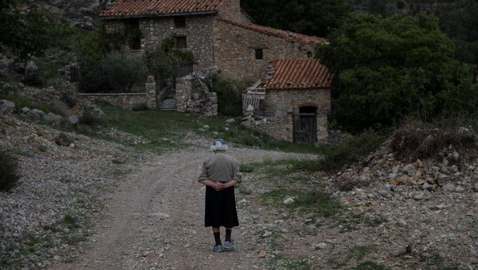 Sinforosa Sancho, 85, takes a walk in the empty village of La Estrella, Spain. For more than 30 years, Sinforosa and her husband Juan Martin Colomer have lived alone in the village in Spain's eastern highlands that once had more than 200 inhabitants.