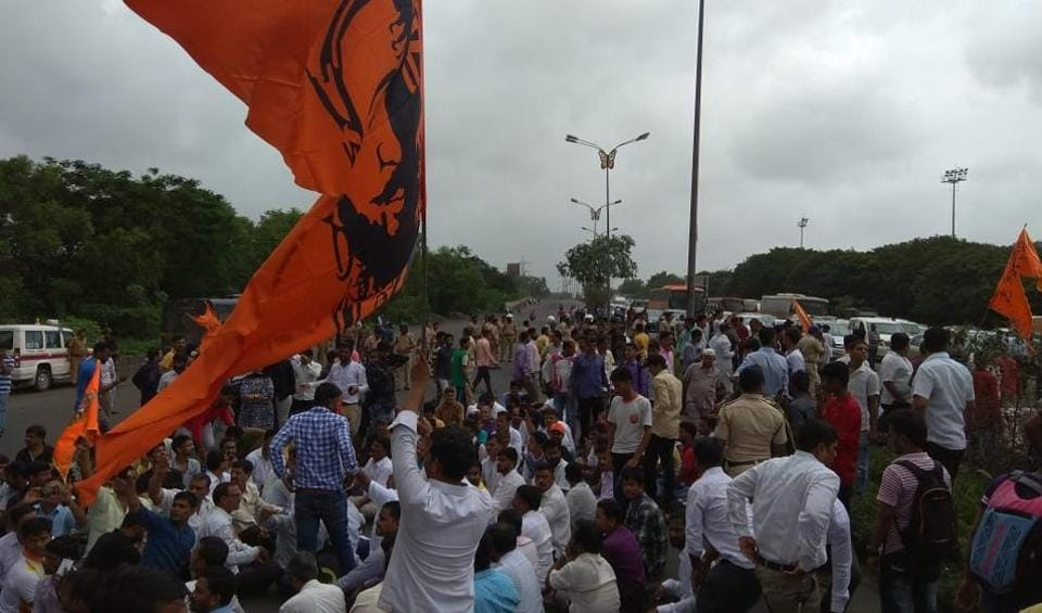 Protesters block the busy Sion-Panvel highway at Vashi on Wednesday.