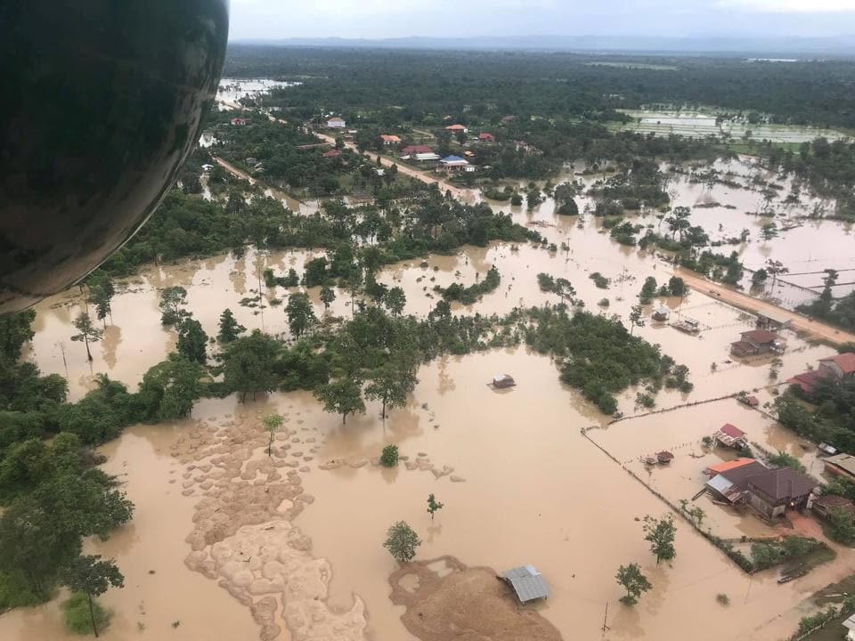 An aerial view shows the flooded area after the dam collapsed. The $1.2 billion dollar Xe-Namnoy dam, a joint venture between Laos and Korean companies, was still under construction in southern Attepeu province when it collapsed after heavy rains pounded the area earlier this week. (Mime Phoumsavanh / REUTERS)