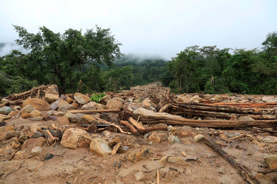 Debris seen in an area affected by landslide after the collapse. The official Laos News Agency said that about 26 people were confirmed dead and more than 130 were missing following the failure of the dam on Monday, a subsidiary structure under construction as part of a hydroelectric project. (Soe Zeya Tun / REUTERS)