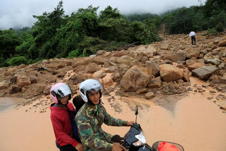 A motor bike pass near land slide area seen after the hydropower dam collapsed in Attapeu province. The scale of the disaster was still unclear, in part because of the inaccessibility of the area but also because reports from the communist country's state media have been scant and sketchy. (Soe Zeya Tun / REUTERS)