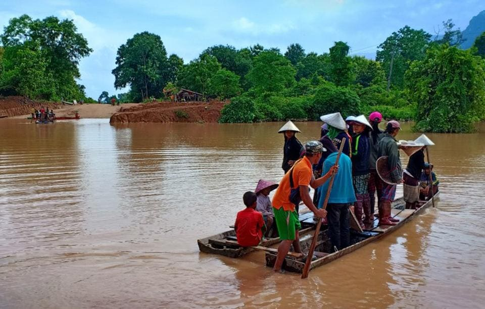 Villagers evacuated after the collapse. A situation report from the U.N. Office for the Coordination of Humanitarian Affairs said roads and bridges were damaged and eight villages had been hit by flash flooding after the failure of the dam. It said boat and helicopter were the only means of transport in the affected areas. (Stringer / REUTERS)