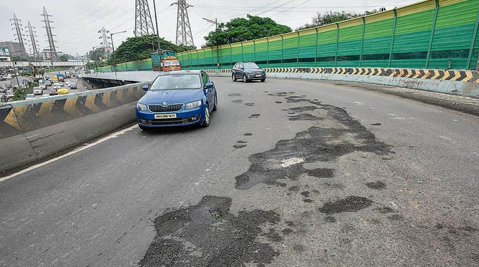 Potholes at Suman Nagar flyover in Mumbai.
