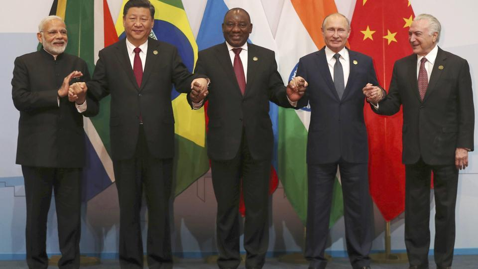 Members of the major emerging national economies group BRICS, with from left, Prime Minister Narendra Modi, China's president Xi Jinping, South African president Cyril Ramaphosa, Russia's president Vladimir Putin, and Brazil's president Michel Temer, as they pose together for a group photo at the BRICS summit in Johannesburg.