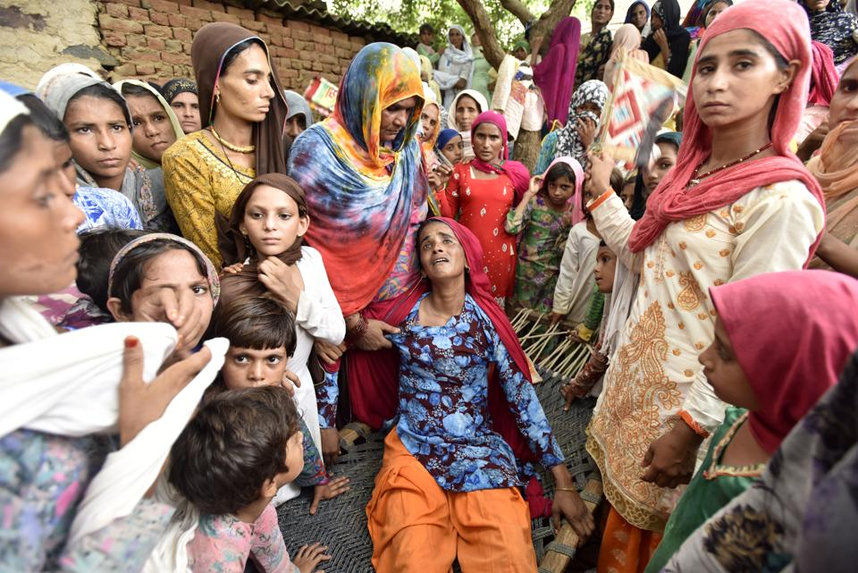Asmina (centre), the wife of Rakbar Khan, 35, a resident of Kolgaon in Haryana, and others mourn the death of her husband who was allegedly lynched by a mob in Rajasthan's Alwar district.