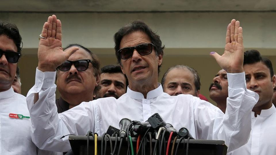 Cricket star-turned-politician Imran Khan, chairman of Pakistan Tehreek-e-Insaf (PTI), speaks to members of media after casting his vote at a polling station during the general election in Islamabad.