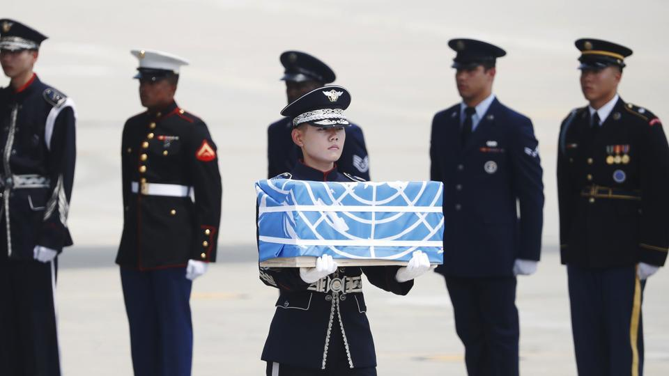 A soldier carries a casket containing the remains of a US soldier killed during the 1950-53 Korean War, after arriving from North Korea at Osan Air Base in Pyeongtaek on July 27, 2018.