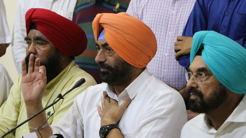 AAP legislators Sukhpal Khaira with other party leaders in Chandigarh.