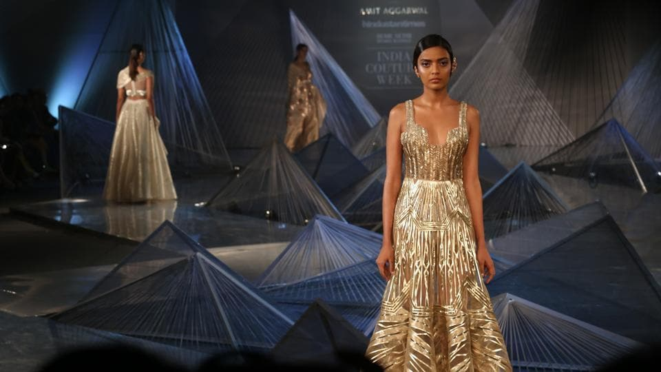 Aggarwal once again opened up new possibilities for fashion's future with tantalising shapes (controlled swoops of volume, classically glam drapes, structured sleeves) and hues (a line-up of bold jewel tones, as well as softer pearls, golds, glacier greens, smoky purples). (Amal KS/HT Photo)