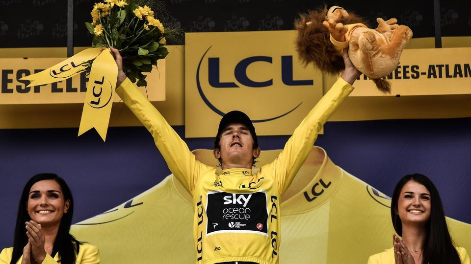 Great Britain's Geraint Thomas, wearing the overall leader's yellow jersey, celebrates on the podium after the 20th stage of the 105th edition of the Tour de France.