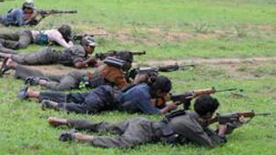Maoists practice shooting at a training camp in Bijapur district of Chhattisgarh.