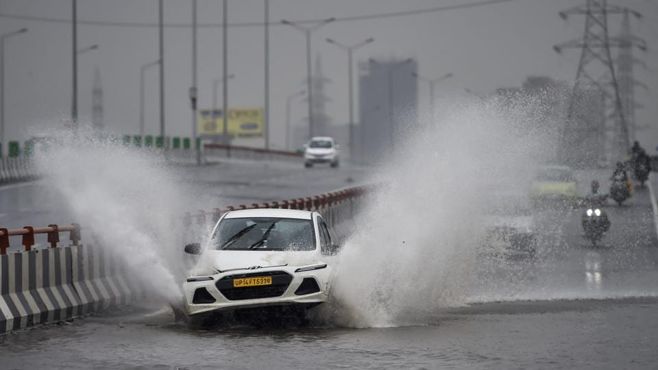 A car wades through a waterlogged road on NH-24 in New Delhi. The national capital recorded its second heaviest spell of monsoon rain this season, as the downpour that started on Thursday pounded the city through the night and into Friday before letting up at noon. Heavy rain also lashed other parts of the Delhi-NCR. (Ravi Choudhary / PTI)