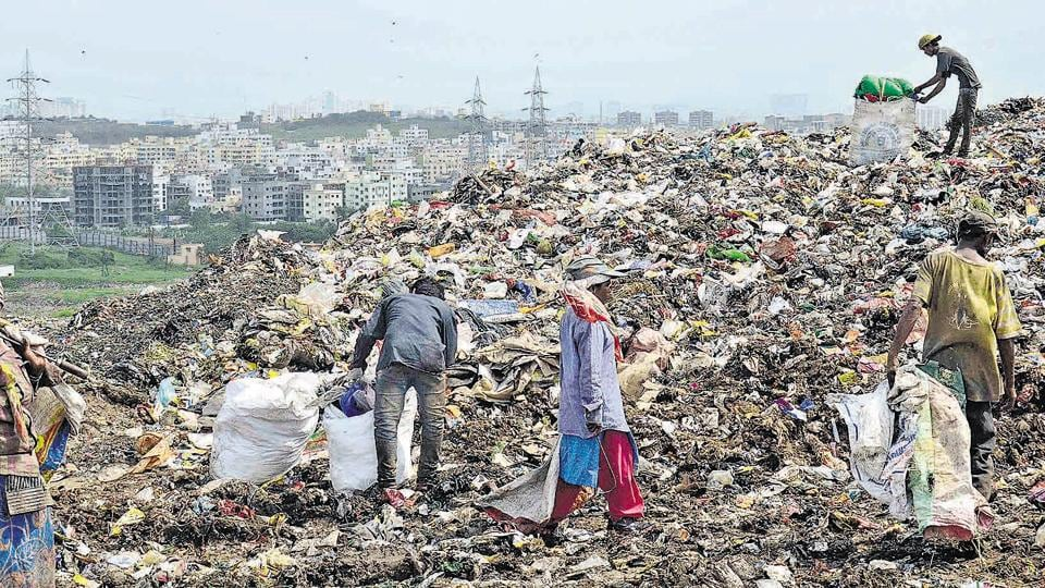 Waste pickers try to find something valuable from the garbage dumping site at Uruli Devachi which reportedly holds around 2.5 lakh metric tonnes waste.