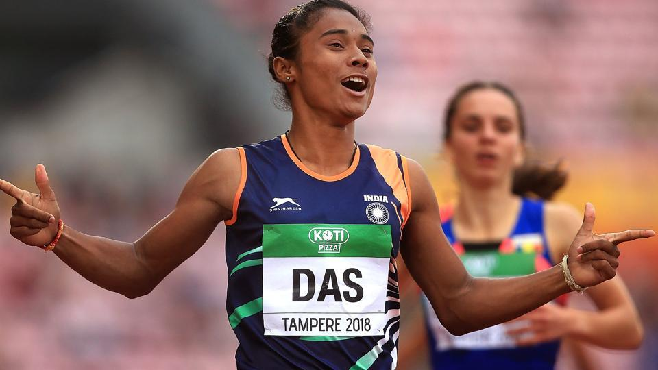 Hima Das celebrates after winning gold in the final of the women's 400m on day three of the IAAF World U20 Championships.