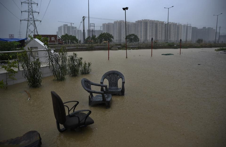 Chairs stand submerged in rainwater outside a roadside shop during heavy monsoon rainfall in Greater Noida. The water level of the Yamuna in Delhi breached the warning level of 204m after Haryana released more water. An alert has been sounded by the Delhi government after the water level crossed the danger mark, an official said. (R S Iyer / AP)