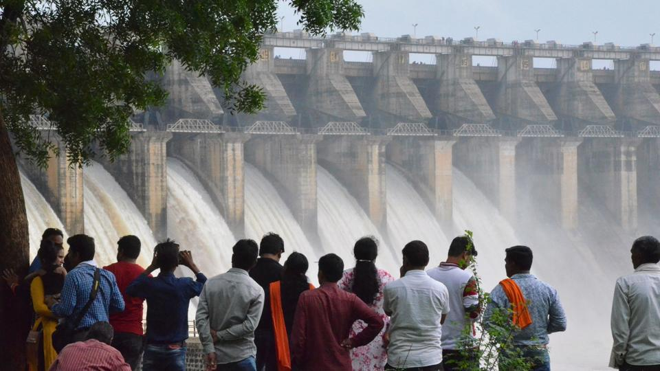 People watch water pour out of seven of 21 gates of the Bargi Dam that were opened after excess rain in Jabalpur, Madhya Pradesh. In Himachal Pradesh, sudden release of water from the 243-megawatt Kashanghydel power project in Kinnuar caused immense damage to apple orchards and pine forests in the tribal district. (AFP)