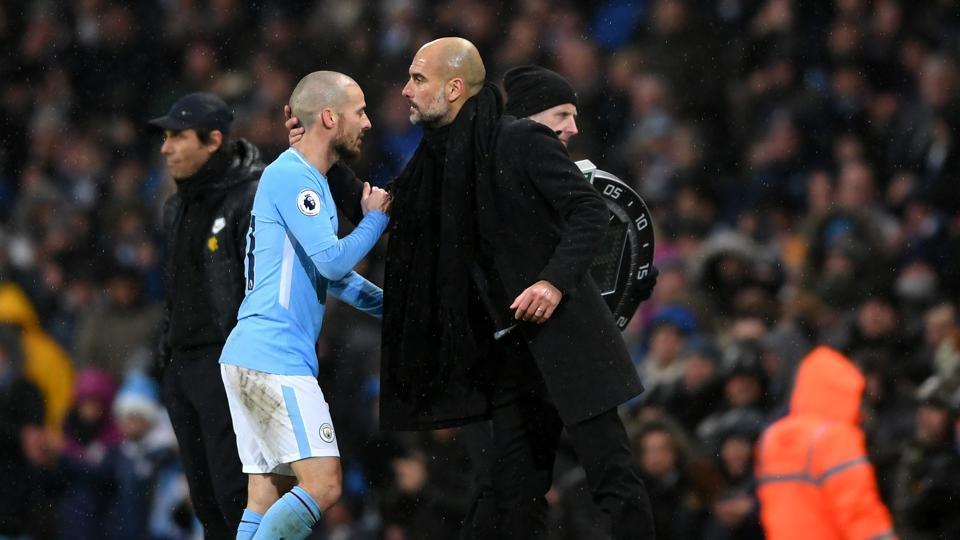 David Silva embraces Josep Guardiola, Manager of Manchester City during the Premier League match.