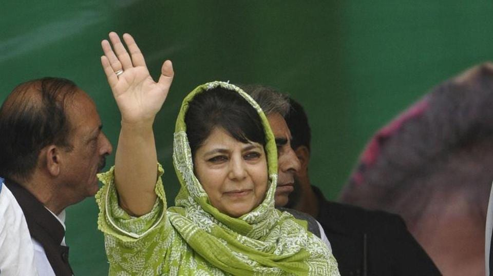 Jammu and Kashmir chief minister Mehbooba Mufti waves to supporters during a function in Srinagar.