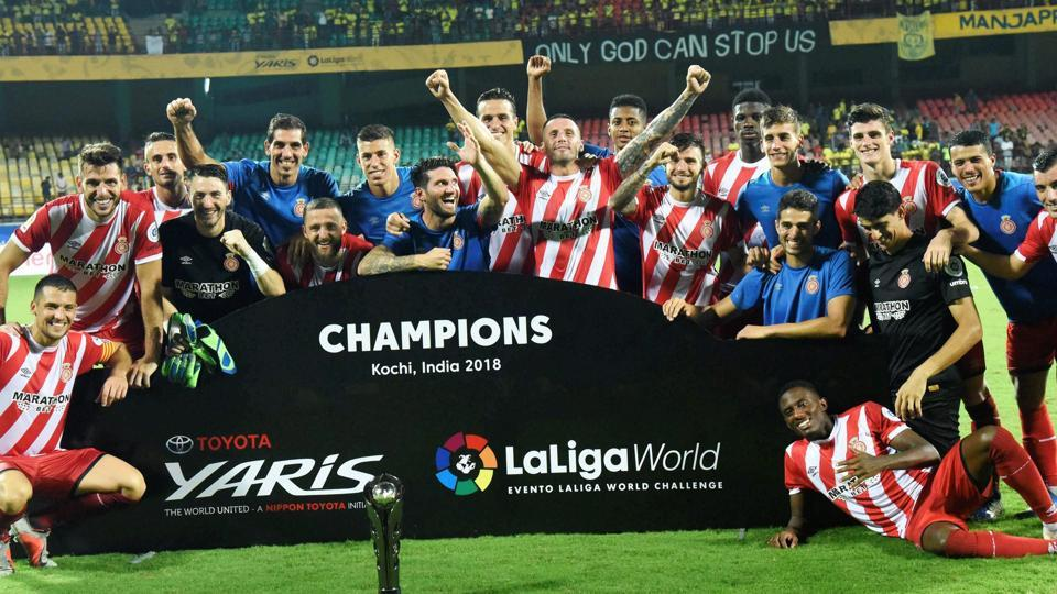 Girona FC players celebrate after they beat Kerala Blasters during the  La Liga World football tournament, in Kochi on Saturday.
