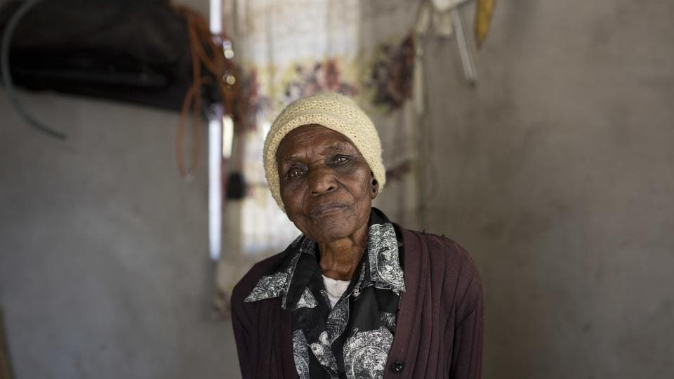 Ellis Ndlovu, 91, poses for a portrait in her Simbumbumbu, Zimbabwe home. Ndlovu's son, Edwel, was killed 34 years ago by Zimbabwe army soldiers in what many called the Matabeleland Massacres.