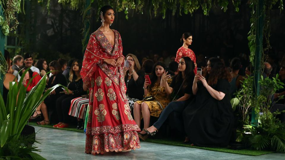 Intricate resham thread work took center stage through clustering palms, budding lotuses, miniature carnations and complex geometrical patterns inspired from Mughal architecture and miniature paintings. (jasjeet plaha/ht photo)