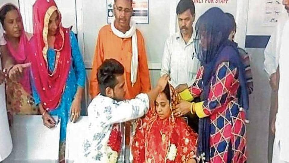 Gurmukh Singh and Ruby performing the wedding rituals at a private hospital in Hisar on Saturday